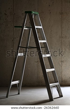 Step ladder in a basement - stock photo