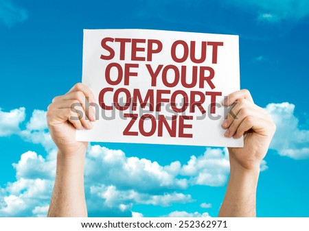 Step Out of Your Comfort Zone card with sky background - stock photo