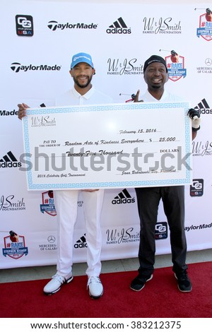 Stephen Bishop and Ricky Smith with donation (Will and Jada Smith Foundation) at the inaugural Stephen Bishop celebrity golf invitational on Feb. 15, 2016 at Calabasas Country Club in Calabasas, CA. - stock photo
