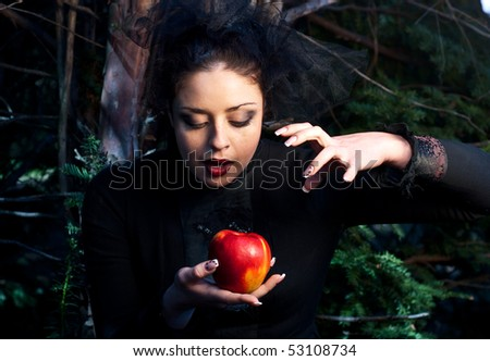 stepmother casts a spell over the apple - stock photo
