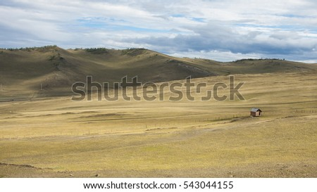 Steppe in Siberian. Baikal. Mountains. Prairie. Blue sky. Rural.  Adventure