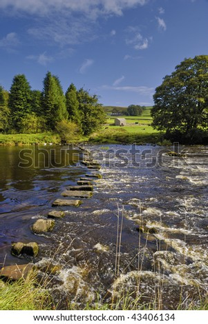 Stepping stones across the river Wharfe in the Yorkshire Dales National Park, England - stock photo