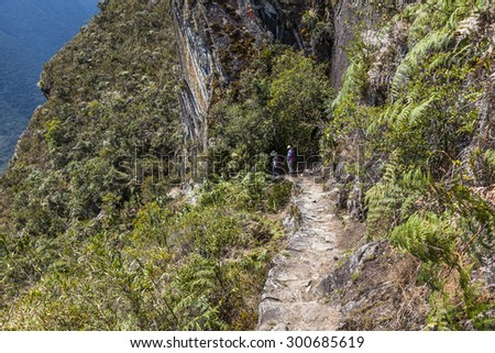 Steps carved into the rock in Machu Picchu, was designed Peruvian Historical Sanctuary in 1981 and a World Heritage Site by UNESCO in 1983. - stock photo