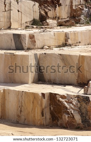 Steps in a marble quarry left after the extraction of the blocks, Alentejo, Portugal - stock photo