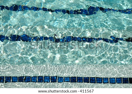 Steps in a swimming pool - stock photo