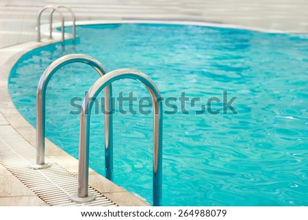 steps in a water pool - stock photo