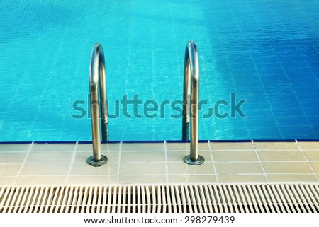 steps in blue water pool - stock photo