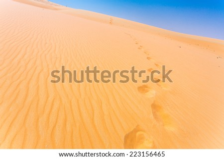 Steps in sand - stock photo