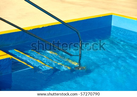 Steps into a swimming pool - detail - stock photo
