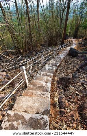 Steps Leading down a Narrow way - stock photo