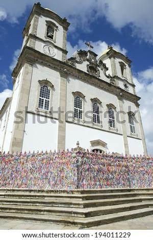 Steps leading up to colorful wall of wish ribbons at the entrance to the Igreja Nosso Senhor do Bonfim da Bahia church in Salvador Bahia Brazil - stock photo