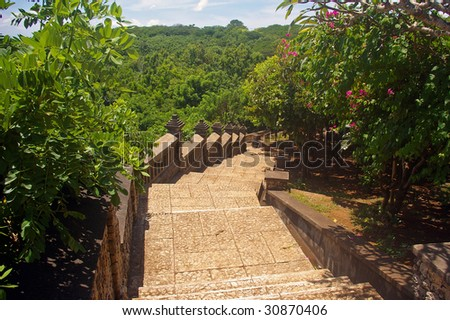 Steps leading up to the famous Luhur temple, sometimes known as the  Monkey temple in Uluwatu, Bali, Indonesia. - stock photo