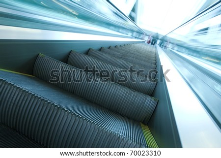 steps of blue moving escalator - stock photo