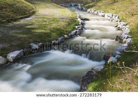 steps of fish ladder in river  - stock photo