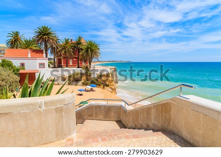 Steps to beautiful beach in Armacao de Pera coastal town, Algarve region, Portugal - stock photo