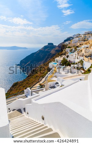 Steps to beautiful Firostefani village with typical white architecture and view of caldera, Santorini island, Greece - stock photo
