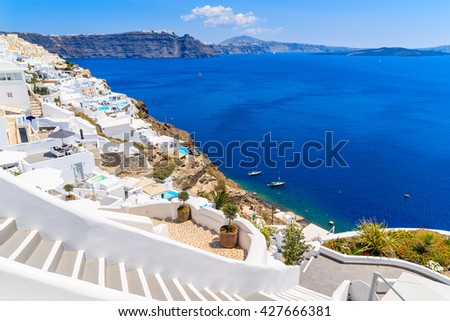 Steps to beautiful Oia village with typical white architecture and view of caldera, Santorini island, Greece - stock photo
