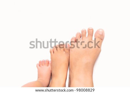 Steps to success - multi size foot from infant, young children and adult - stock photo