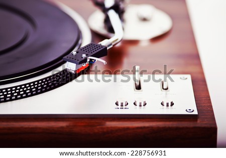 Stereo Turntable Vinyl Record Player Analog Retro Vintage Closeup - stock photo