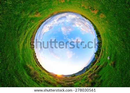 Stereographic panoramic projection of a green field in the summer