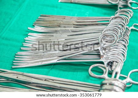 Sterile surgical instruments on the table - stock photo