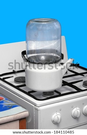 Sterilisation of glass jars at home conditions - stock photo