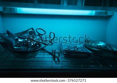 sterilizing the medical instrument - stock photo
