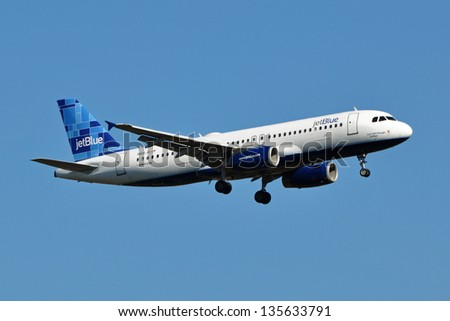 STERLING, USA - NOVEMBER 9, 2011: A JetBlue Airbus A320 lands at Washington Dulles International Airport. JetBlue Airways is an American low-cost airline which is headquartered in New York City. - stock photo