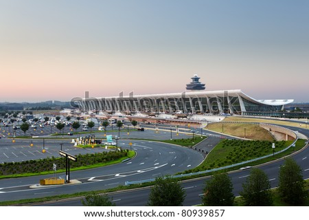 STERLING, VA - JULY 10: Washington Dulles International Airport at dawn on July 10, 2011. Dulles Airport is at the center of controversy over the location and cost of the planned metro station. - stock photo