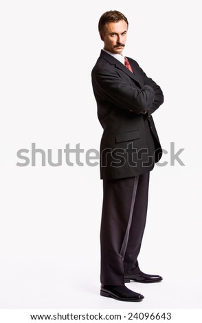Stern businessman with arms crossed - stock photo