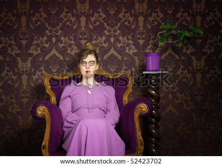 Stern lady in a purple setting - stock photo