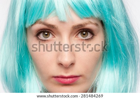 Stern looking crazy girl with bright colourful wig. - stock photo