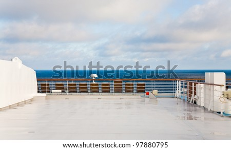 stern of cruise liner in sea at summer morning - stock photo