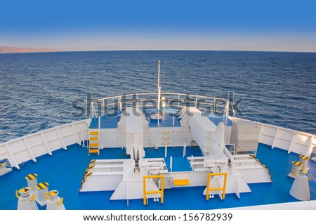 stern of the ship in the blue sea - stock photo