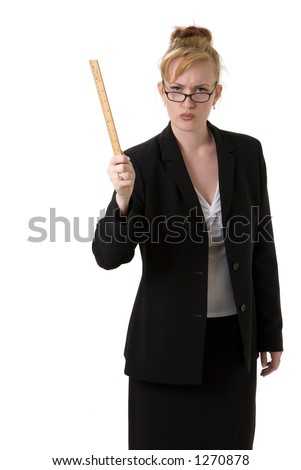 Stern Principal holding ruler - stock photo