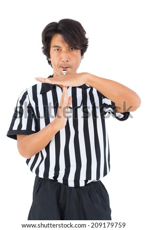 Stern referee showing time out sign on white background - stock photo
