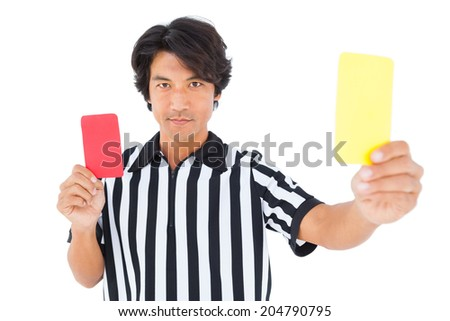 Stern referee showing yellow card on white background - stock photo
