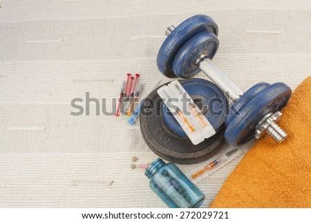 steroids, muscle-building, dangerous sport, sports fraud - stock photo