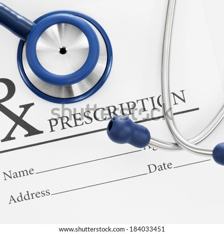 Stethoscope above blank medical prescription - 1 to 1 ratio - stock photo