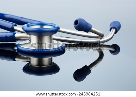 stethoscope against white background, photo icon for the medical profession and diagnostics - stock photo