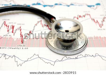 Stethoscope and a stock chart - market analysis. - stock photo