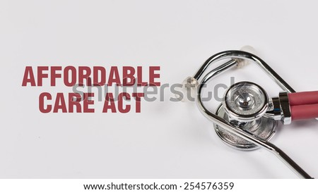 Stethoscope and Affordable Care Act note on White Background - stock photo