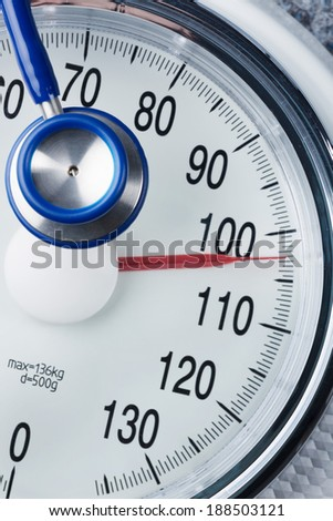 stethoscope and balance, symbol photo for weight, diet and heart disease