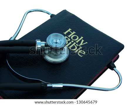Stethoscope and Bible - stock photo