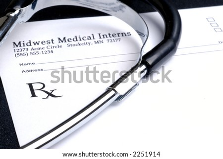 Stethoscope and Blank Prescription Pad - stock photo