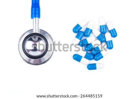 Stethoscope and blue and white capsule for the treatment