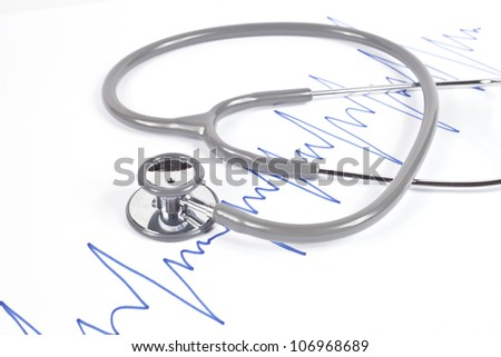 Stethoscope and blue graph on white - stock photo