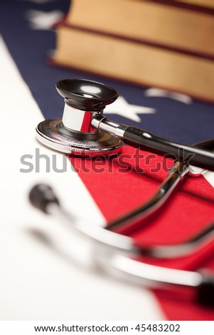 Stethoscope and Books on American Flag with Selective Focus.