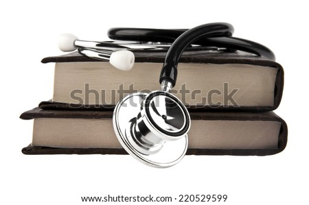 stethoscope and books on white background - stock photo