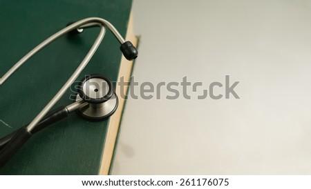 stethoscope and books on white background. - stock photo